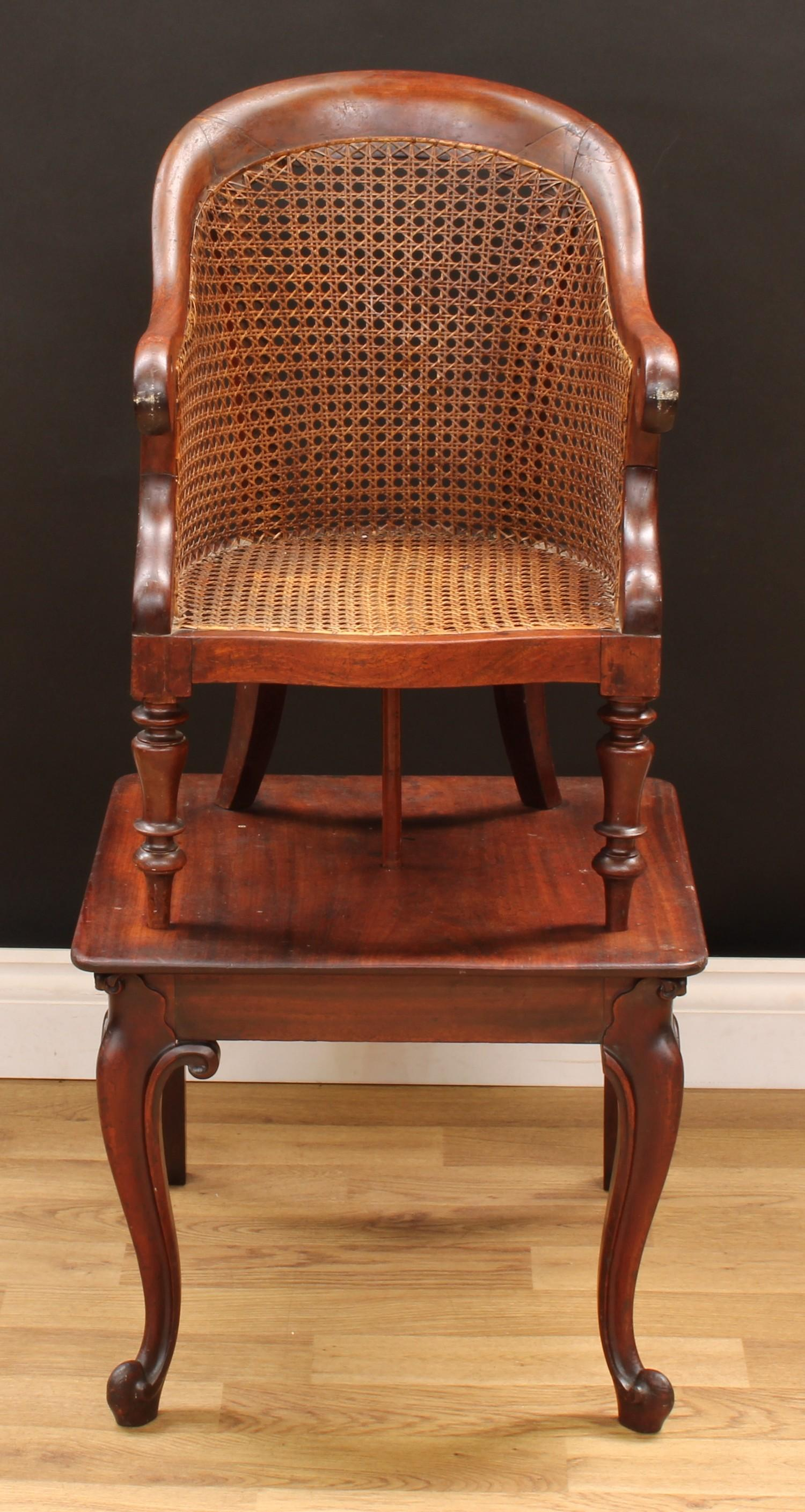 A Victorian mahogany child's combination high chair and table, curved back terminating in scroll