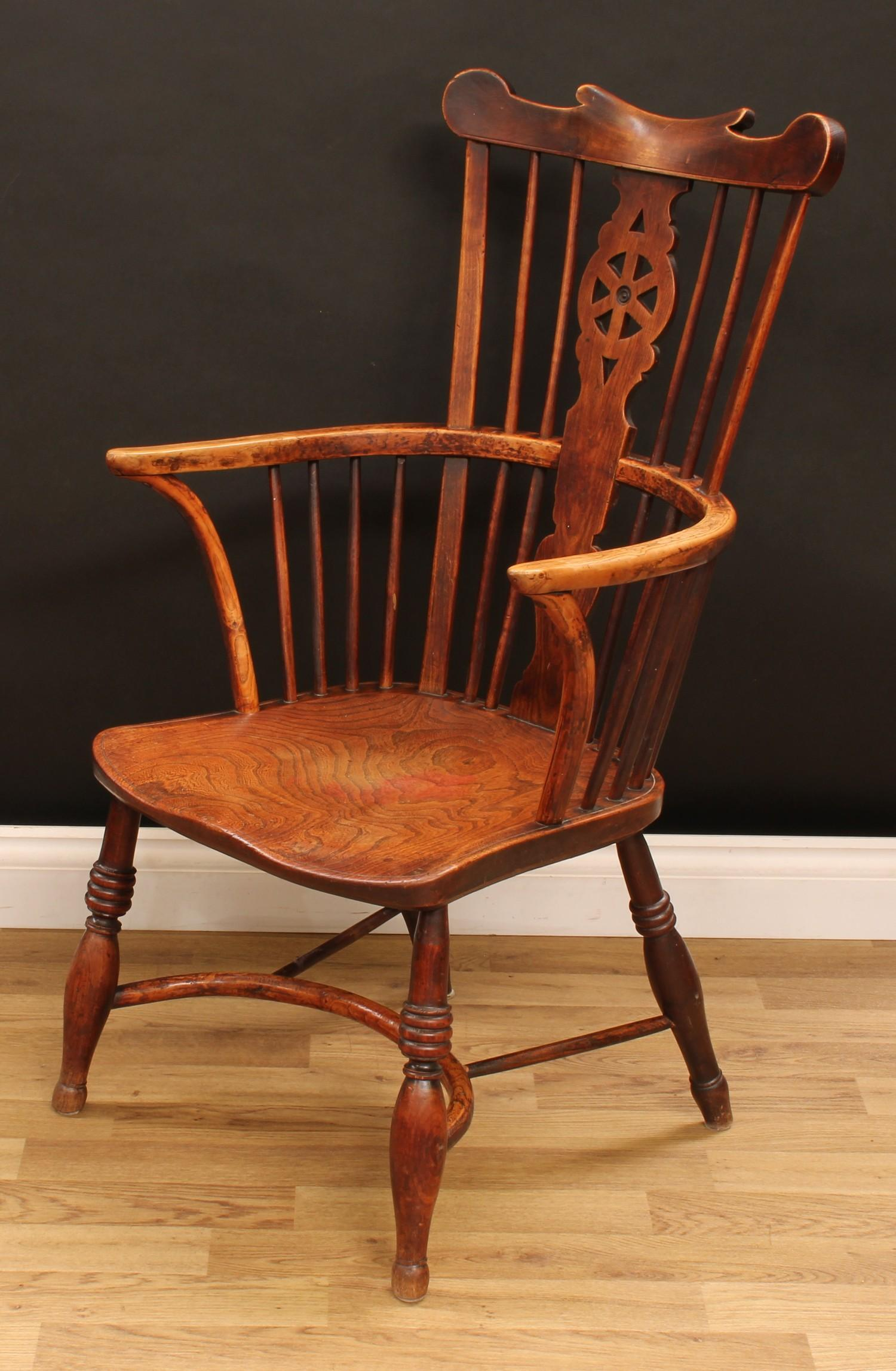 A country house ash and elm Windsor elbow chair, shaped cresting rail above a wheel back splat, - Image 3 of 4