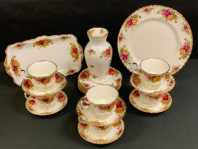 A Royal Albert Old County Roses tea service, for six, printed marks; a similar vase