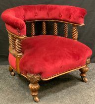 A late Victorian oak club chair, curved upholstered back with spindle gallery, stuffed-over seat,