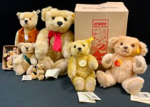 Steiff - a Steiff Classic 1909 jointed bear, red ribbon, 37cm long; another, smaller, 24cm high;