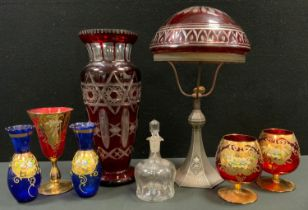 An early 20th century Bohemian domed table lamp, the metal base embossed and fluted, c.1910; a