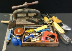 Tools - a Victorian cast iron book press; vintage oil can; another draper; clamps, hammers, glue