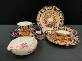 A Royal Crown Derby miniature coal scuttle, pattern 2649; a 2451 pattern teacup, saucer, side plate;