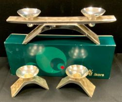 A Kurt Radke for WMF brushed steel three piece candle garniture, comprising two light candelabra,