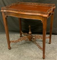A reproduction regency style silver table, pierced gallery, tapered reeded legs, 74cm high 68cm