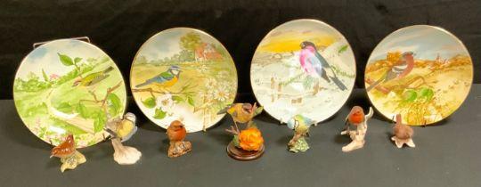 A Beswick bird, Robin, 980; Blue Tit, 992; Wren 993, others, Goebel; four Crown Staffordshire