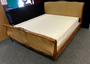A Louis XV style king size bergere bed, by And so to bed London, 194cm wide, 226cm long, 114cm high;