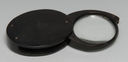 A 19th century horn pocket lens, folding for travel, 8cm wide