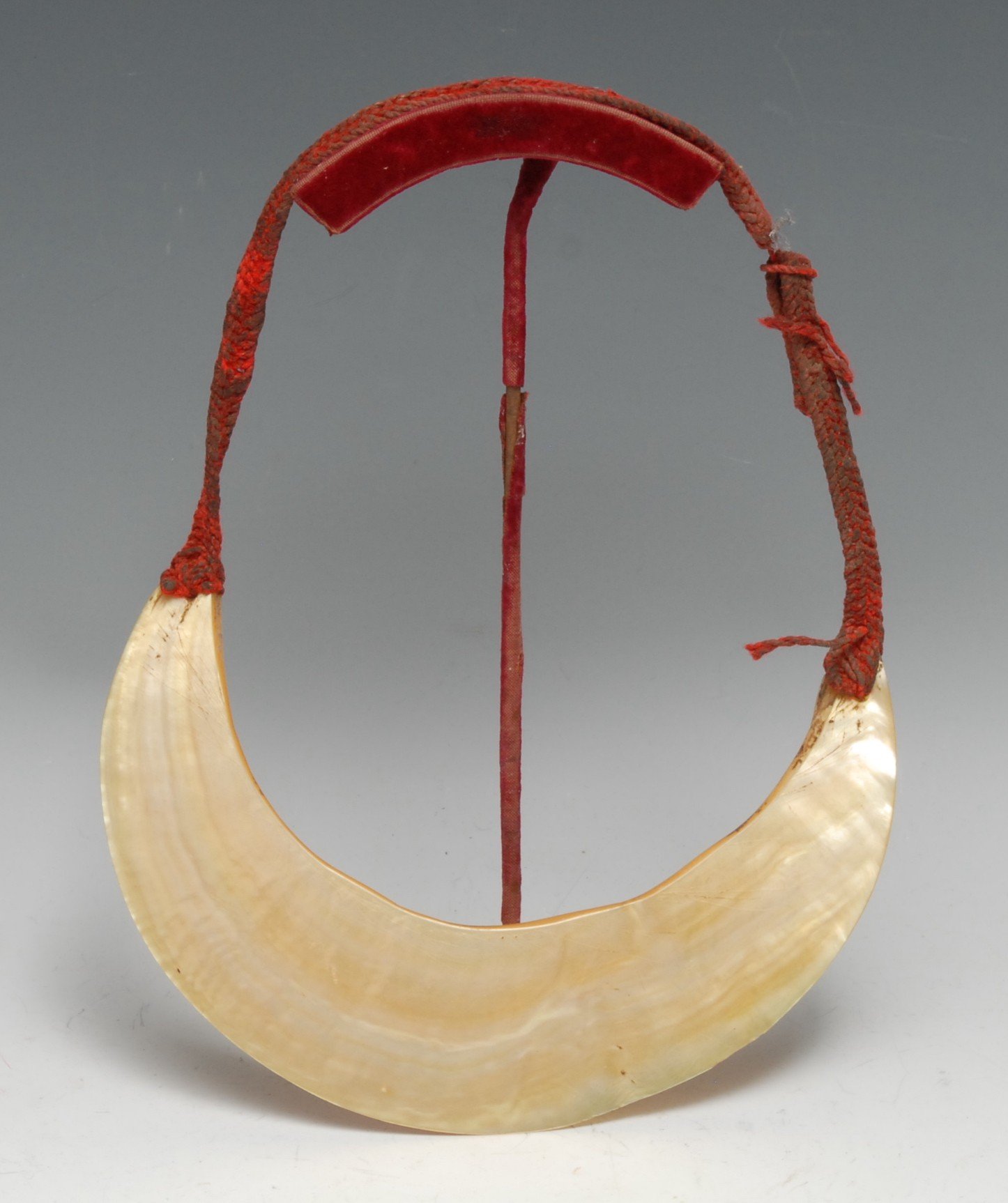 Tribal Art - a Polynesian pearl shell neck ornament, 21.5cm wide, 18cm wide, display stand, Papua