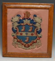 A 19th century Berlin woolwork armorial panel, depicting the arms and motto of Rugby School, on a