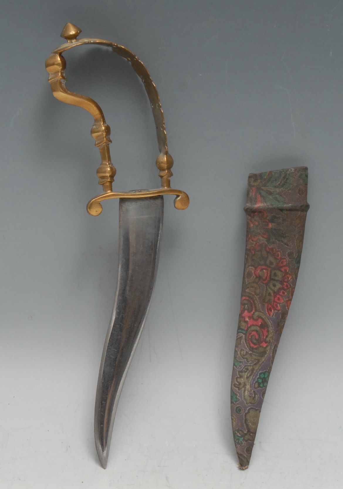An Indian bichuwa, 14.5cm curved blade, gilt brass knuckle-bow hilt, 23cm long overall, 19th century