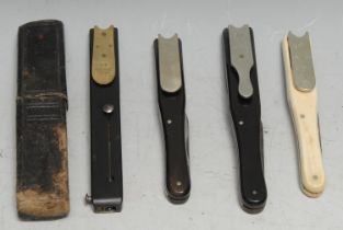 A 19th century ebony quill cutter, by Rodgers, Sheffield, tooled slip case; others, similar (4)