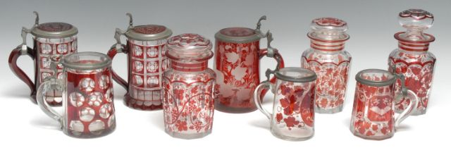 A 19th century Bohemian ruby glass stein, intaglio cut with a king making a toast, on a ground of