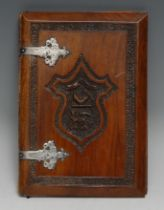 A 19th century Anglo-Indian silver coloured metal mounted hardwood blotter or album, carved to recto