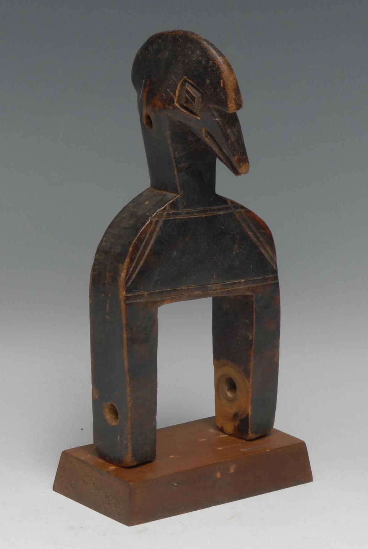 Tribal Art - a Senufo heddle pully figure, carved as a stylized bird, 21cm high, Ivory Coast, West