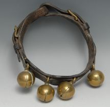 A 19th century leather animal collar, with four crotal bells, 20cm diam