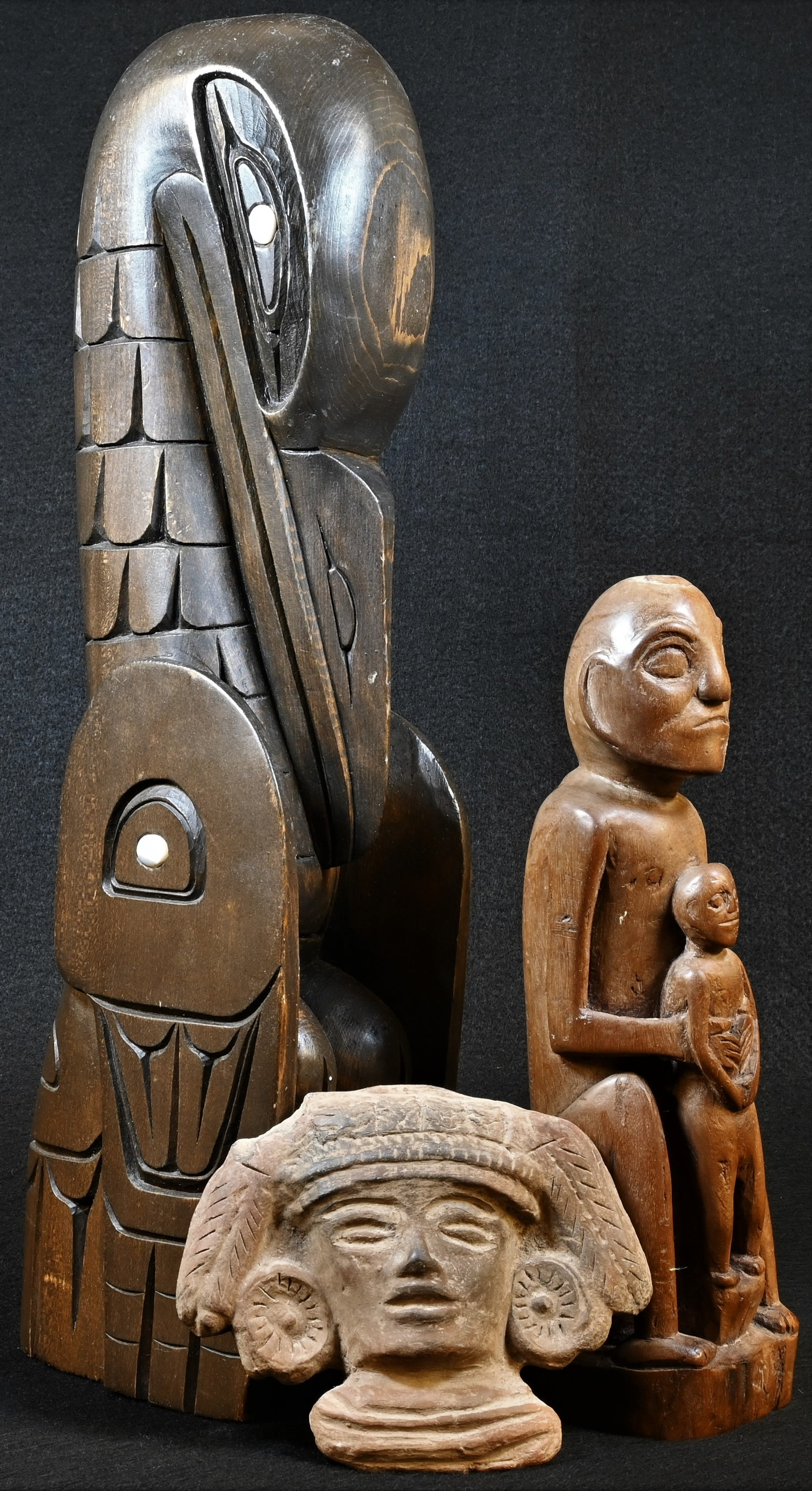 Tribal Art - a hardwood figural carving, probably Indonesian, 22cm high; a totem, 38cm high;