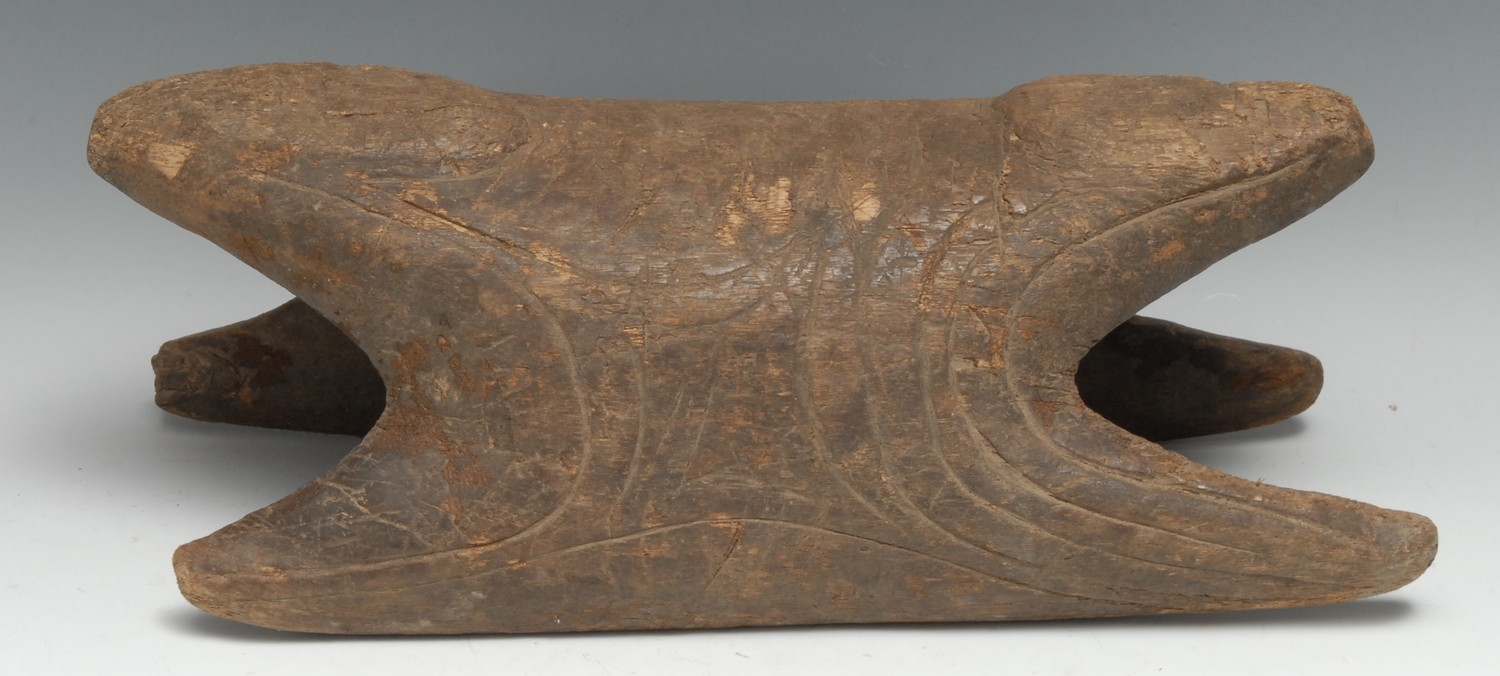 Tribal Art - a Papua New Guinea stool, possibly from a canoe, incise-carved with geometric motifs,