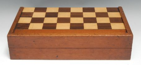 A 19th century mahogany and parquetry rectangular games box, inlaid for chess, the interior with