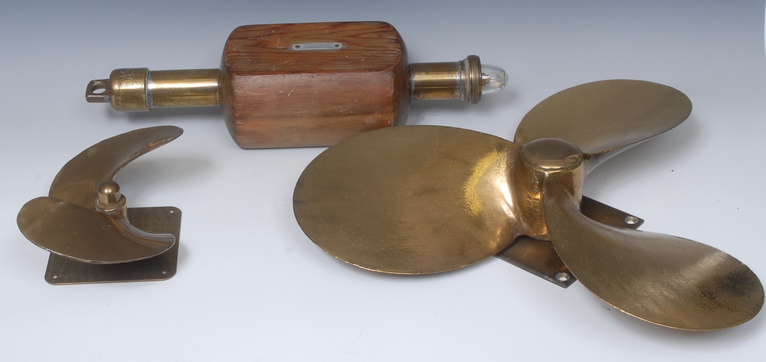 A three blade brass ships propeller; another smaller; a brass and pine marker buoy, marked EASCO (3)