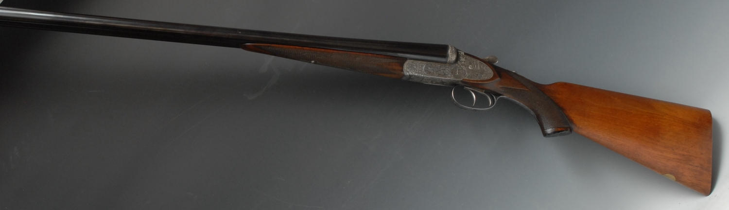 12 Bore Side by Side side lock ejector shotgun serial number 33150. Barrel length 28 inches.