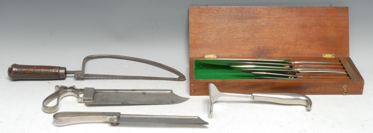 Medical - an early 20th century surgeon's saw, by Thackray, Leeds and London, 27.5cm long; others,