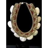 Tribal Art - a Papua New Guinea neck adornment, composed of graduating cowrie shells and beads on