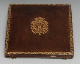 A 19th century Continental tooled and gilt leather medallion or seal presentation case, the hinged