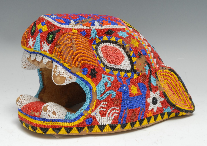 Tribal Art - a Huichol (aka Wixárika) beadwork jaguar head, decorated in brilliant colours on a