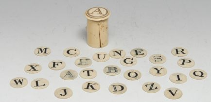 A 19th century bone child's teaching spelling alphabet, the circular counters contained within a