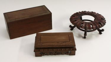 A 19th century Chinese hardwood connoisseur's vase box, the sliding cover enclosing a silk-lined
