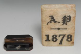 A 19th century alabaster book shaped desk weight, initialled AP and dated 1878, 10.5cm long; a