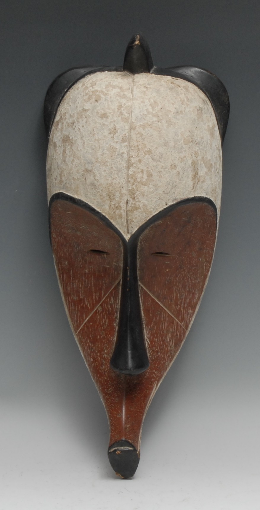 Tribal Art - a Fang Ngil mask, typically elongated concave stylised features, picked out with