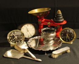 A silver three piece vanity set, Birmingham 1939; 1960's/70's alarm clocks; a set of Thornton Viking