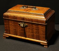 An early 19th century mahogany tea caddy, swing handle, locking with a key, 27cm wide