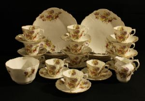 An Aynsley tea set for twelve, printed and painted with summer flowers, moulded with scrolls and