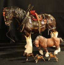 A Beswick model of a shire horse, matt brown glaze, 21cm high, printed mark in black; a set of three