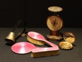 A silver engine turned pink enamel dressing table set, hand mirror and two brushes, Birmingham 1929;