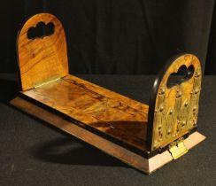 A Victorian burr walnut Betjemann's patent bookslide, bookslide, retailed by Hall & Co,