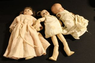 Toys and Juvenalia - a painted composition head and shoulder doll, stuffed cloth body, inset blue