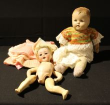 A Heubach and Koppelsdorf bisque head doll, composite body, needs re-stringing; a celluloid doll (2)