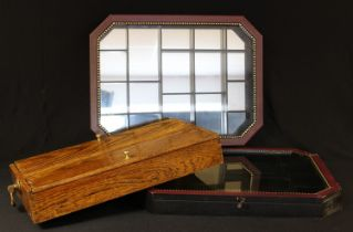 An oak cutlery box, two hinged covers, pair of brass loop swing handles, green baize lined, 43cm