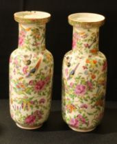 A pair of Chinese famille rose bottle vases; enamelled with pink blossom, birds and insects, 24cm,