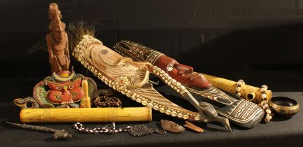 Tribal Art - a cowrie shell necklace; a Polynesian style wall mask; arrow tubes; other similar; qty