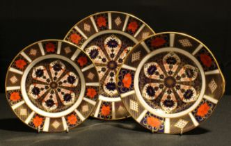 A Royal Crown Derby Imari 1128 pattern dinner plate, sandwich plate, side plate, all first