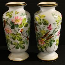 A pair of Limoges tapering cylindrical shoulder vases, painted with birds perched amongst leafy pink