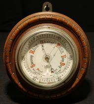 A Victorian walnut aneroid barometer, 12cm register inscribed J W Butler, Optician, Scarborough, the
