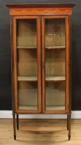 An Edwardian mahogany display cabinet, moulded cornice with shallow chequered parquetry apron
