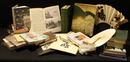Japanese tour guide books, British cultural guides in Japanese, reference books; a geisha doll;
